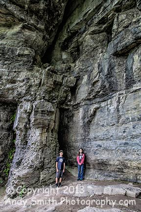 Colby and Caitlyn under towering cliffs on the Indian Ladder Trail