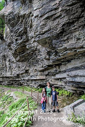 Colby and Caitlyn with Kim on the Indian Ladder Trail below towering cliffs